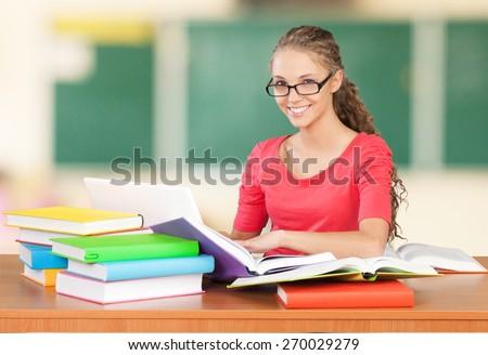 Student. Hispanic student doing homework - stock photo
