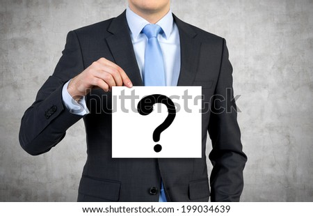 Student holding a poster 'question mark'  - stock photo
