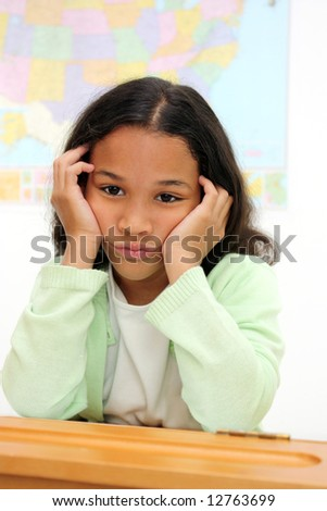 Student in a classroom at elementary school - stock photo