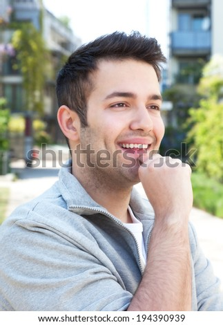 Student in a grey jacket outdoors dreaming on a summer day - stock photo