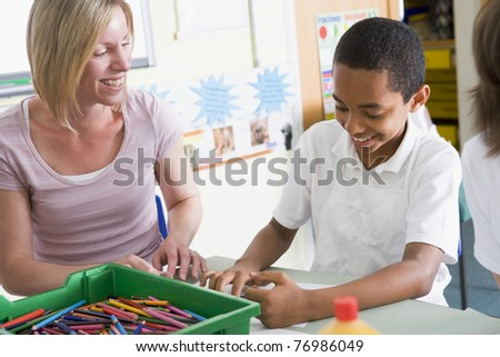 Student in art class with teacher - stock photo