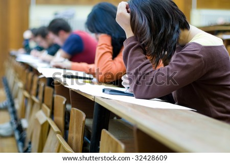 Student in class having an exam in school - stock photo