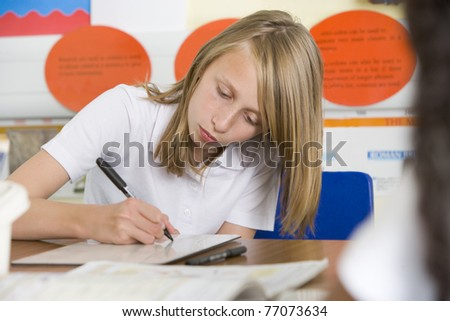 Student in class taking notes - stock photo
