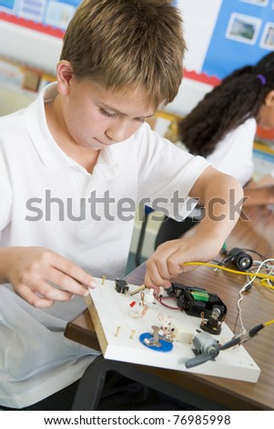 Student in class with electronic project (selective focus) - stock photo