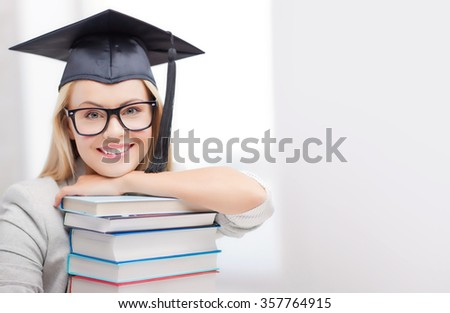 student in graduation cap - stock photo