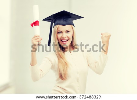 student in graduation cap with certificate - stock photo