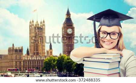 student in trencher cap with books over london