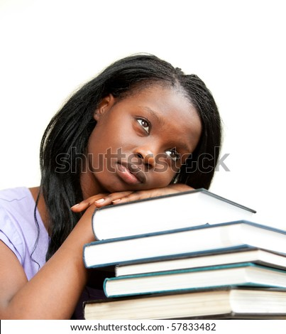 Student leaning on a stack of books against a white background - stock photo