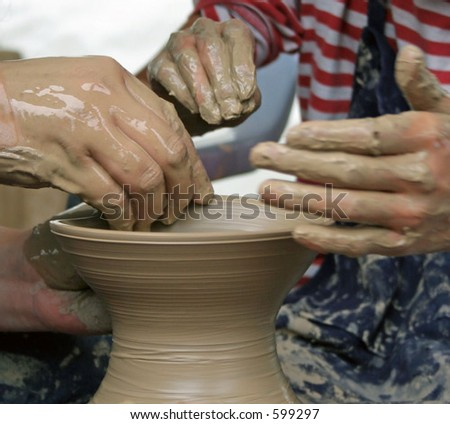 Student learning how to make pottery