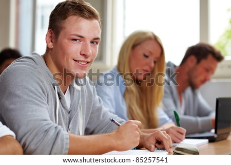 Student learning in class in a university - stock photo