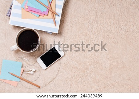 Student life: books, textbooks, magazines, notebooks, coffee and glasses on the floor, preparing for exams. - stock photo