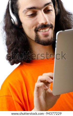 Student listening music with tablet computer