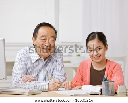 Student listening to grandfather explain homework