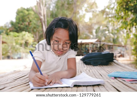 Student little asian girl, countryside in Thailand