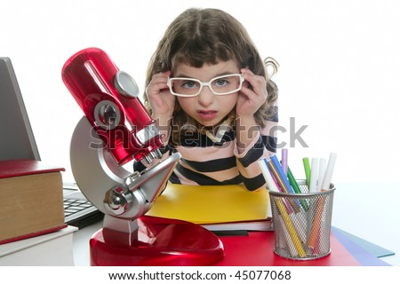 student little girl with microscope and laptop on desk white background