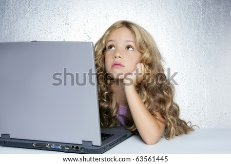 Student little school girl homework on laptop computer silver background