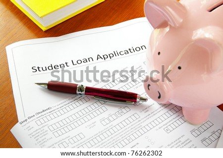 student loan application and piggy bank - stock photo