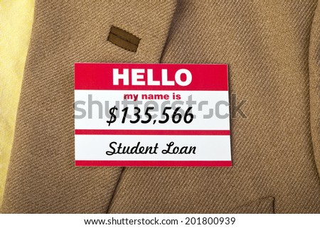 Student loan name badge on jacket. - stock photo