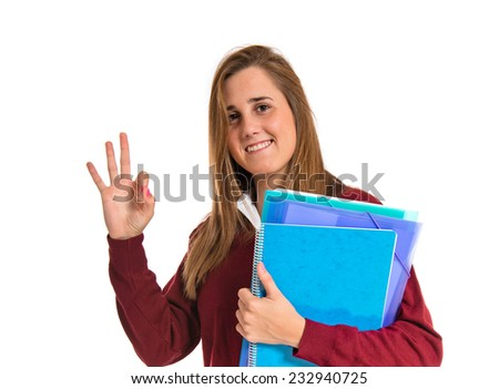 Student making Ok sign over white background - stock photo