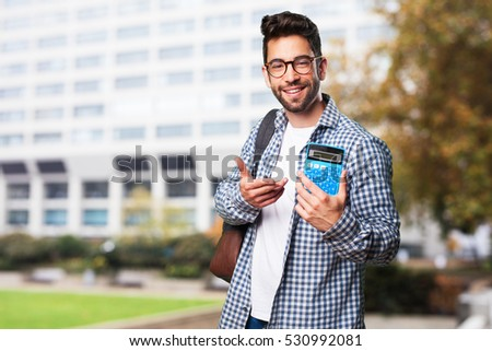 student man holding a calculator