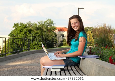 Student on campus with laptop