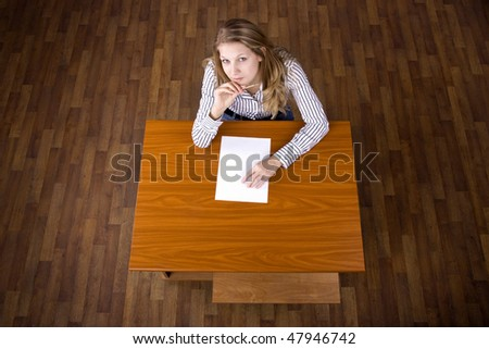 Student on examination looking for the help - stock photo