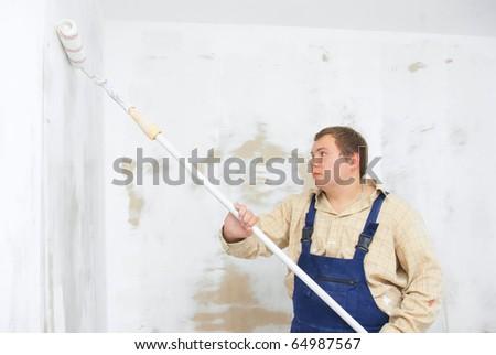 student painter make renovation indoor - stock photo