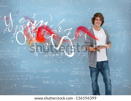Student posing in front of chalk board in a classroom