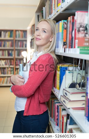 student preparing exam and learning lessons in school library, making research