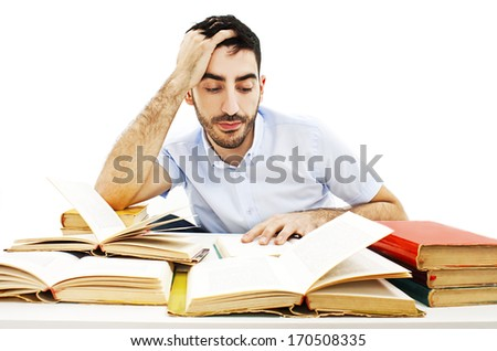 Student preparing for the exams. Isolated on white background  - stock photo