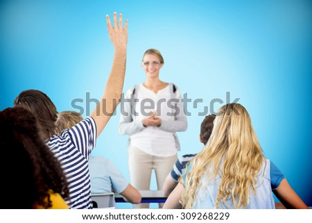 Student raising hand in classroom against blue background with vignette - stock photo