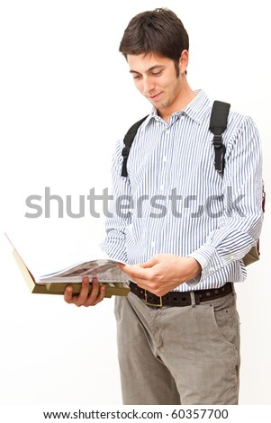 Student reading a book isolated on white