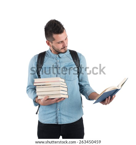Student reads the story lesson for exams - stock photo
