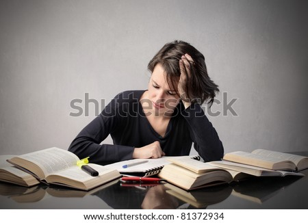 Student revising for an exam - stock photo