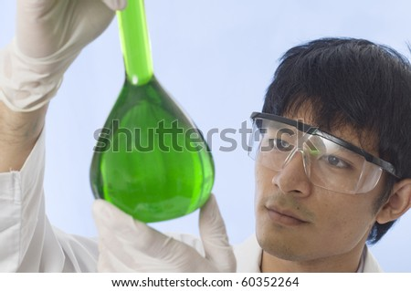 Student Scientist examining in a laboratory - stock photo