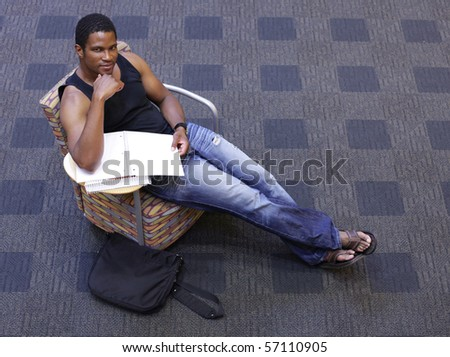 Student sitting in chair Studying at School - stock photo