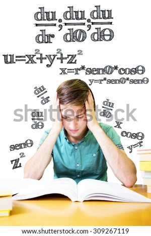 Student sitting in library reading against math equation - stock photo