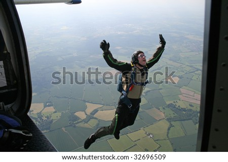 Student skydiver jumps from a airplane - stock photo