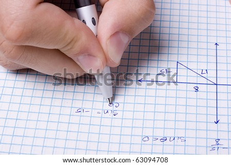 Student solving a math problem using a pen. - stock photo