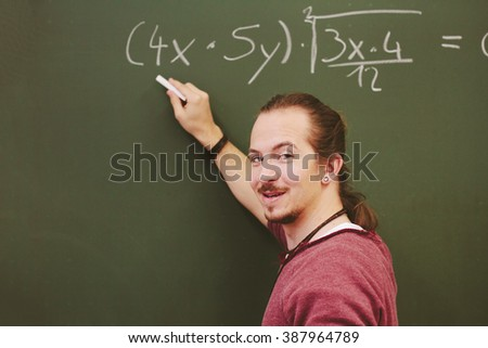 Student standing at the chalkboard and write