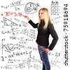 Student standing in front of the blackboard - stock photo