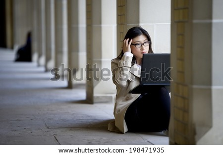 student studying on campus  - stock photo