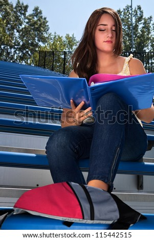 Student studying outdoors - stock photo