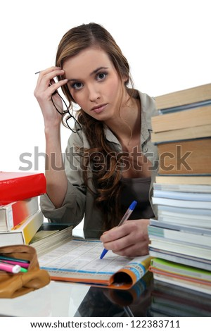 Student surrounded by books - stock photo