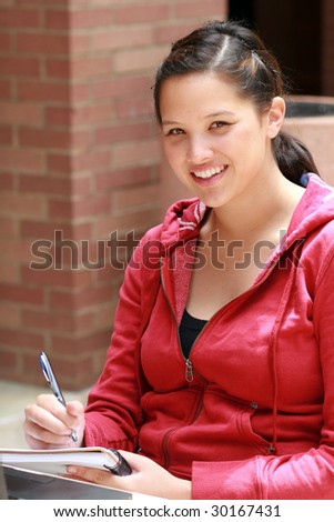 Student taking notes - stock photo