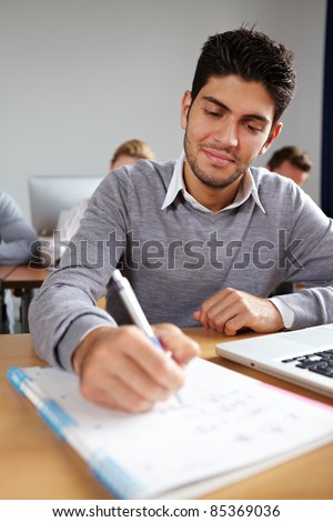 Student taking some notes in university class
