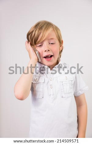 Student talking on mobile phone on white background - stock photo