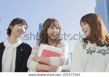 Student talking with friends - stock photo