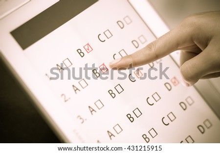student testing in exercise, exams answer on a tablet with multiple-choice questions by finger clicking - stock photo
