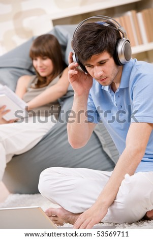Student - Two teenager with laptop and headphones, woman reading book relaxing